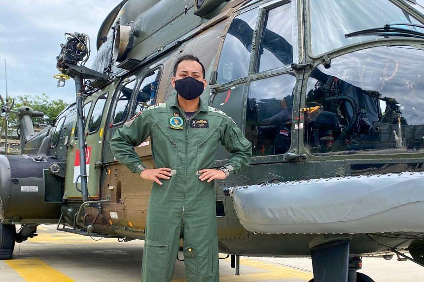 Capt Muhammad Azlan with a RSAF Super Puma helicopter.