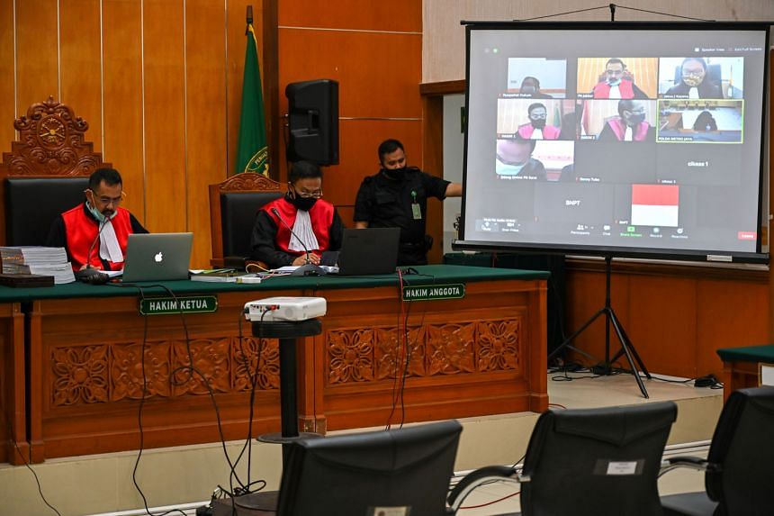 The trial of Syahrial Alamsyah and his wife Fitria Diana (both below) conducted over videoconference yesterday. The couple attacked then Security Minister Wiranto during his visit to Pandeglang regency on Java island last October. Alamsyah was jailed