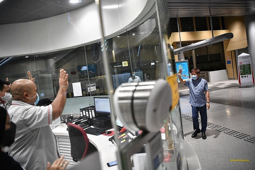 Mr Khaw Boon Wan, who has anchored Sembawang GRC for more than a decade, waving to SMRT staff at Canberra MRT station yesterday. ST PHOTO: ARIFFIN JAMAR