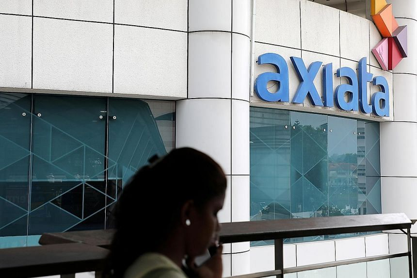 Axiata's headquarters in Kuala Lumpur. Great Eastern will get a 21.875 per cent stake in the venture, which will fund the expansion of Axiata Digital's financial services business over the next year in Malaysia and the region.