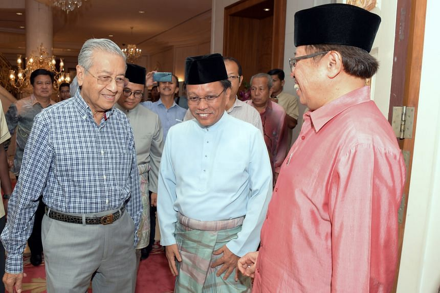 Datuk Seri Shafie Apdal (centre) with former Malaysian Prime Minister Mahathir Mohamad on June 24, 2018.