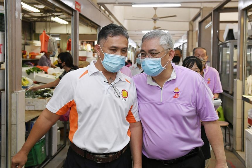 Democratic Progressive Party secretary-general Mohamad Hamim Aliyas with People's Power Party secretary-general Goh Meng Seng during a walkabout at MacPherson Market and Food Centre on June 27, 2020.