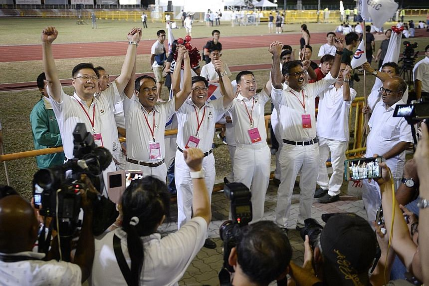 PAP Aljunied GRC candidates (from left) Chua Eng Leong, Shamsul Kamar, Yeo Guat Kwang, Victor Lye and Murali Pillai at Toa Payoh Stadium in 2015 before the results of the recount of votes were announced. They lost to the WP by a razor-thin margin. Al