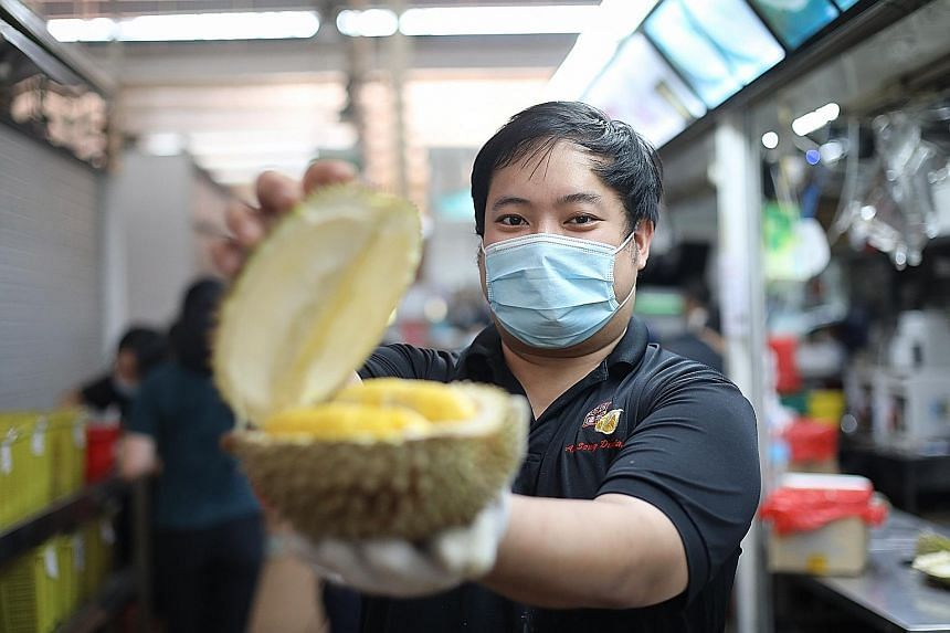Mr Cedrick Shui, second-generation owner of Ah Seng Durian at Ghim Moh Market, says the Mao Shan Wang variety accounts for 80 per cent of sales. The shop sells about 500kg of durians a day.