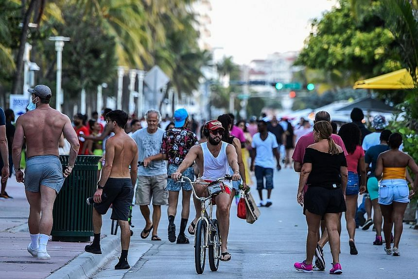 The Ocean Drive walkway in Miami Beach, Florida, was packed with crowds on Friday. There has been a surge in new coronavirus cases in southern and western US states, including Florida and Texas.