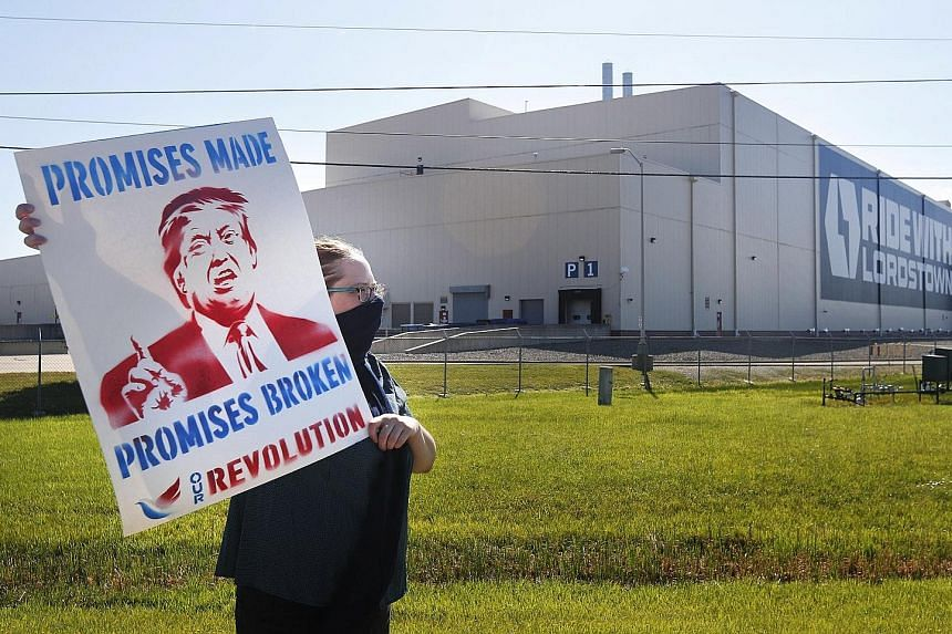 A protester calling for US President Donald Trump's election promises to be fulfilled, outside Lordstown Motors Corp in Warren, Ohio, on Thursday. US Vice-President Mike Pence was visiting the city to speak at the unveiling of a new all-electric pick