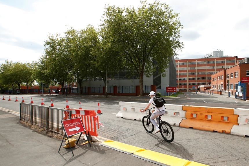 A cyclist is seen using a temporary cycling lane in Leicester, Britain, on May 17, 2020.