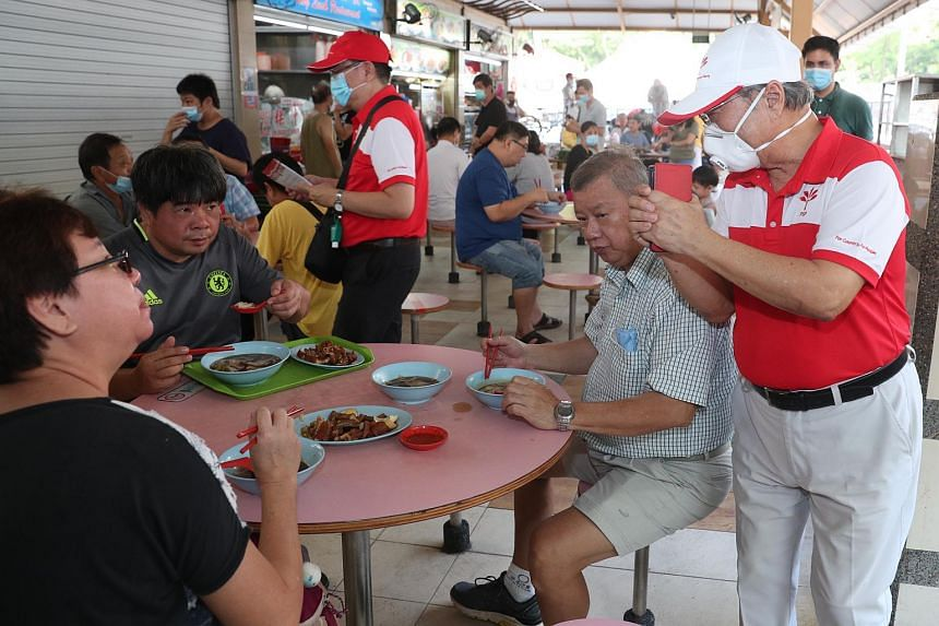 PSP chief Tan Cheng Bock (right) interacting with residents at Boon Lay Place Market and Food Village on June 28, 2020.