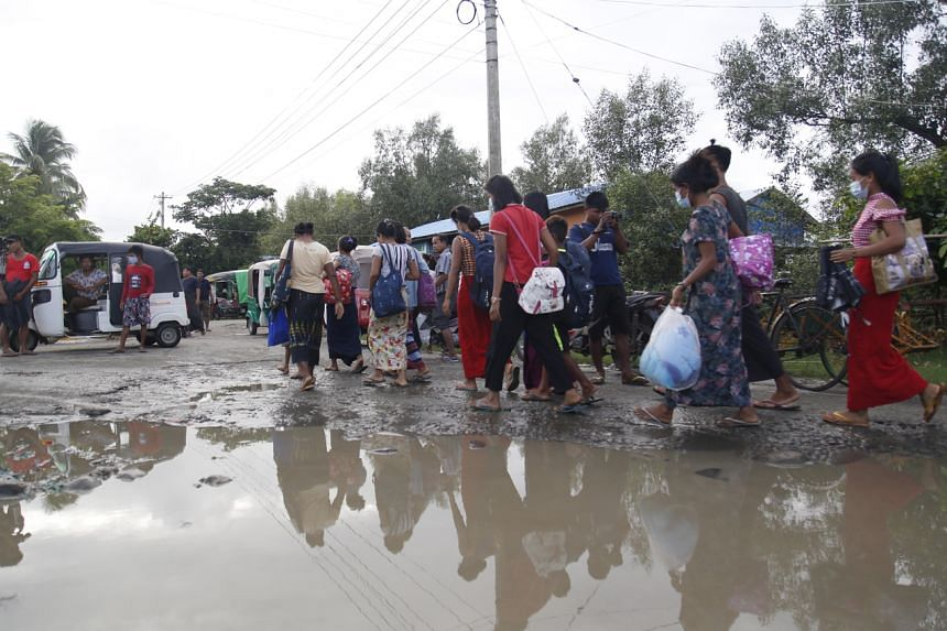 Rakhine people who fled Rathedaung township due to an ongoing conflict between the Myanmar military and the Arakan Army, arriving in Sittwe on June27, 2020.