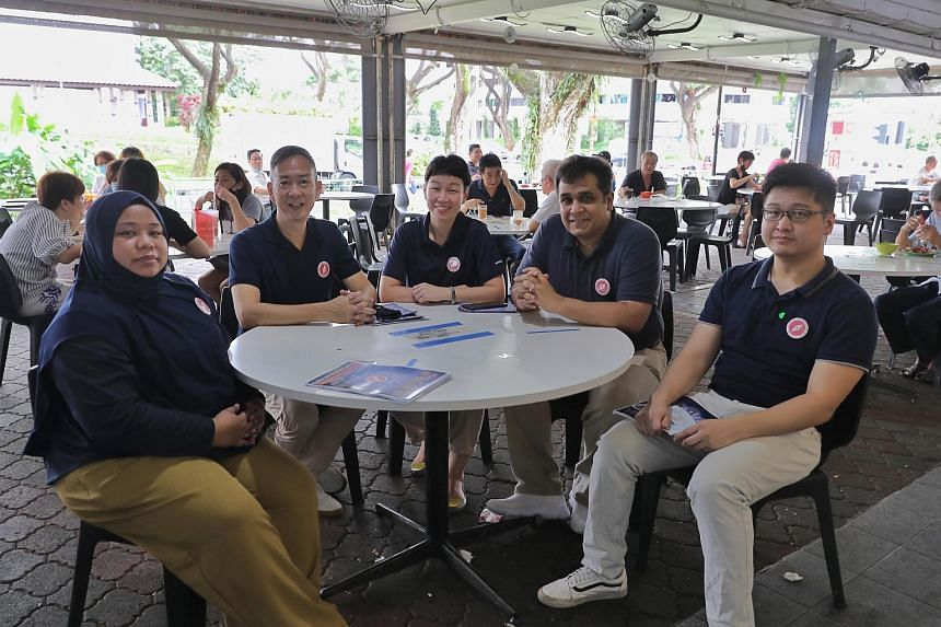 (From left) Red Dot United members Liyana Dhamirah, Alec Tok Kim Yam, Michelle Lee, Ravi Philemon and Nicholas Tang at a coffee shop at Block 503 Jurong West Street 52, on June 28, 2020.