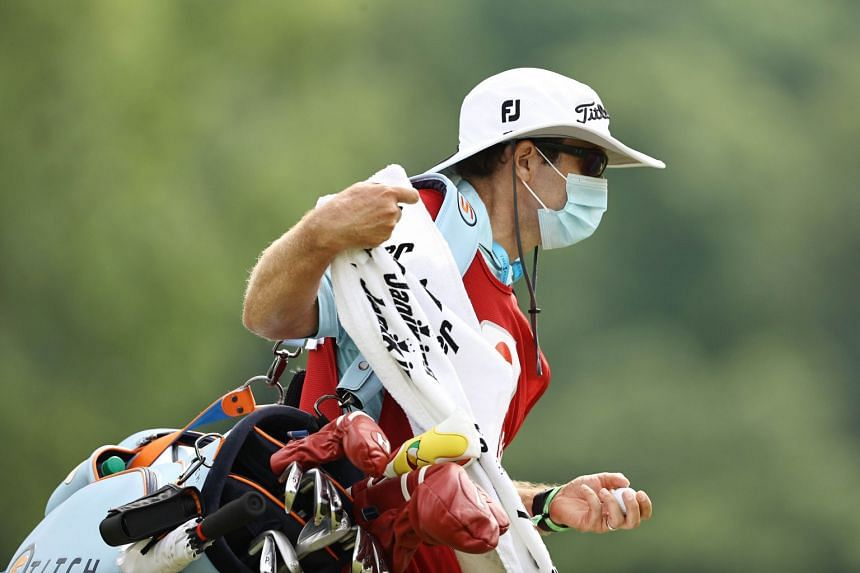 Nick Jones, caddie for the US' Brendon Todd, wears a mask at the Travelers Championship.