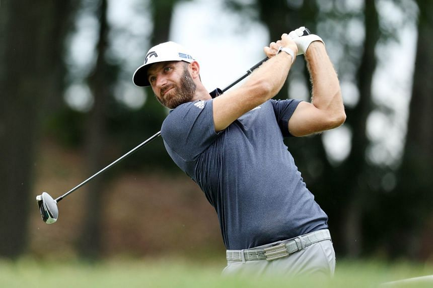 Dustin Johnson plays his shot from the 18th tee during the third round.