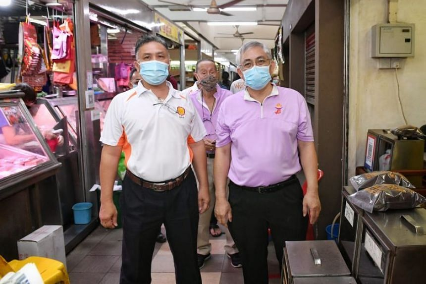 Democratic Progress Party secretary-general Mohamad Hamim Aliyas (left) with People's Power Party secretary-general Goh Meng Seng during a walkabout at MacPherson Market and Food Centre on June 27, 2020.