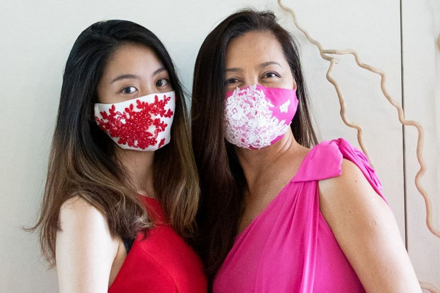 Couturier Ann Teoh and her daughter Christel wearing her hand-sewn limited-edition face masks, which are sold online, with 10 per cent of proceeds going to the Breast Cancer Foundation.