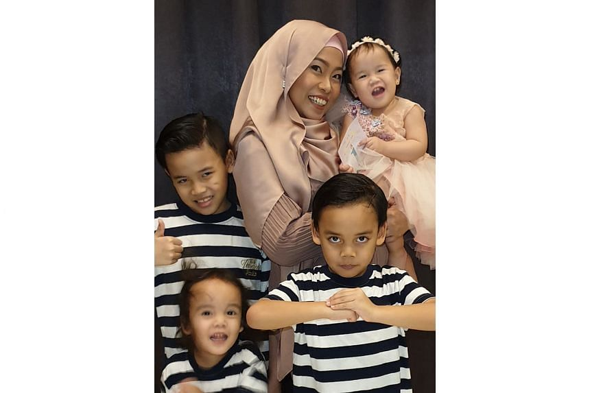 Ms Fathiah Nur Liyana Rokhmat (with her children) switched from making bridalwear to wedding-worthy masks and niqab (face coverings).