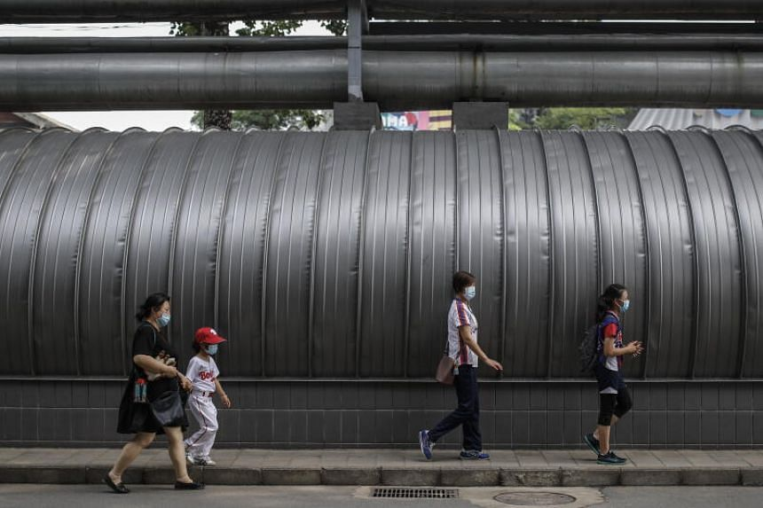 Beijing city authorities have tried to avoid a full lockdown as they battle the virus but have cordoned off several districts.