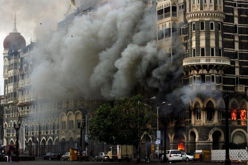 The Taj Mahal hotel is seen engulfed in smoke during a gun battle in Mumbai, on Nov 29, 2008.