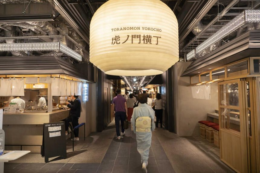 Visitors to the Toranomon Yokocho in the Toranomon Hills Business Tower, which opened to the public on June 11, 2020.