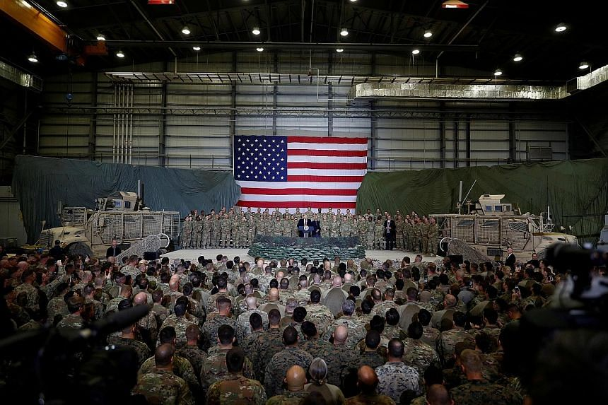 President Donald Trump speaking to US troops during a visit to Bagram Air Base in Afghanistan last November. The New York Times reported last Friday that a Russian military intelligence unit had secretly paid Taleban-linked militants to target coalit