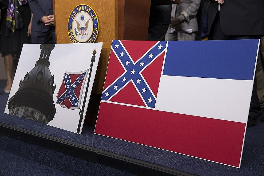 The Confederate battle flag flying in South Carolina (left) and the Mississippi state flag featuring the criss-crossed diagonal stars pattern. PHOTO: EPA-EFE
