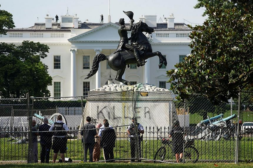 """The word """"Killer"""" is seen on the statue of former US president Andrew Jackson across from the White House last Tuesday, a day after a group of protesters attempted to knock down the statue as part of anti-racism rallies in the United States. Jackson"""