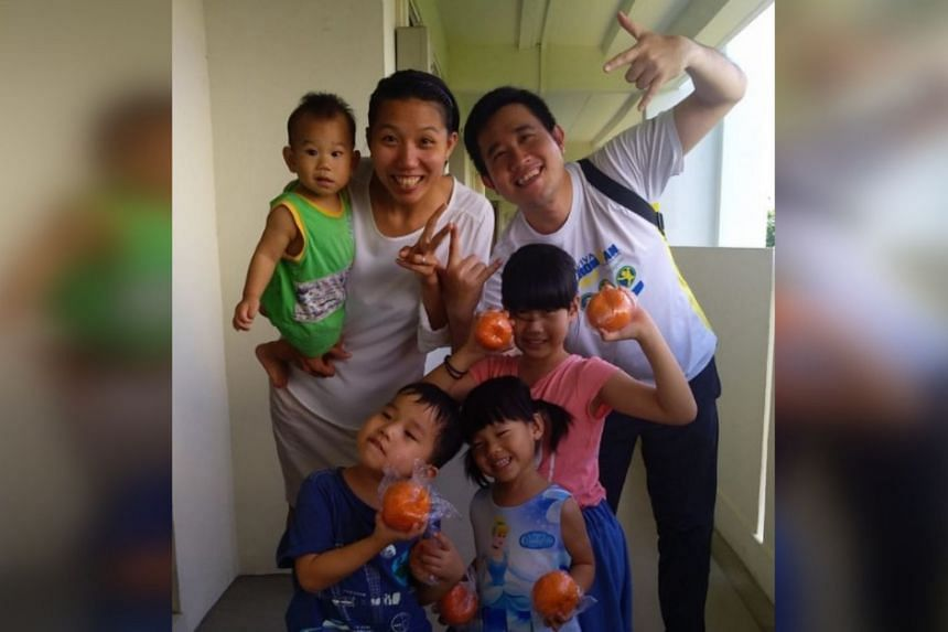 Research engineer Benjamin Lim with his wife, who is a stay-at-home mum, and their four children.