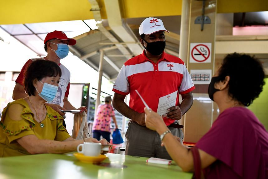 Progress Singapore Party candidate Kumarann Pillai interacts with residents at Mayflower Market and Food Centre on June 28, 2020.