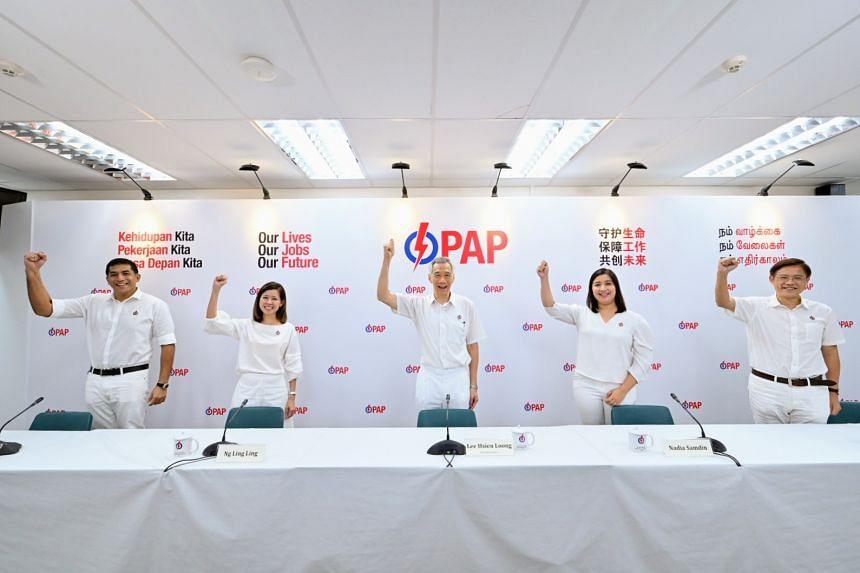 The PAP's Ang Mo Kio GRC team comprises (from left) Mr Darryl David, Ms Ng Ling Ling, PM Lee Hsien Loong, Ms Nadia Ahmad Samdin and Mr Gan Thiam Poh.