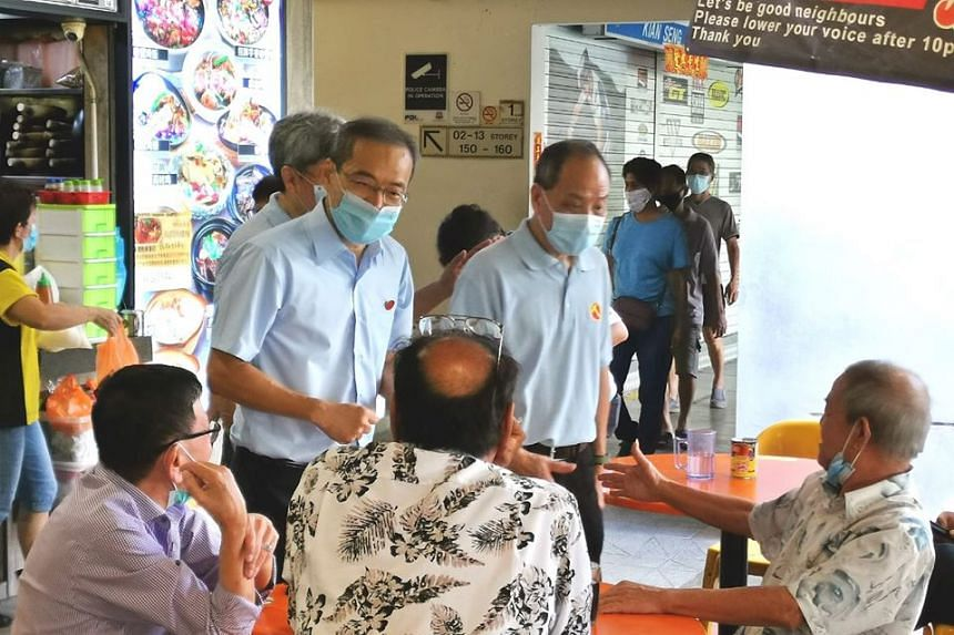 Former WP chief Low Thia Khiang (right) and Mr Png Eng Huat (hidden) joined NCMP Dennis Tan in Hougang to meet residents, on June 28, 2020.