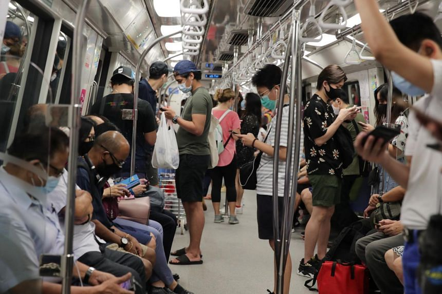 Commuters travel in the train on June 22, 2020.