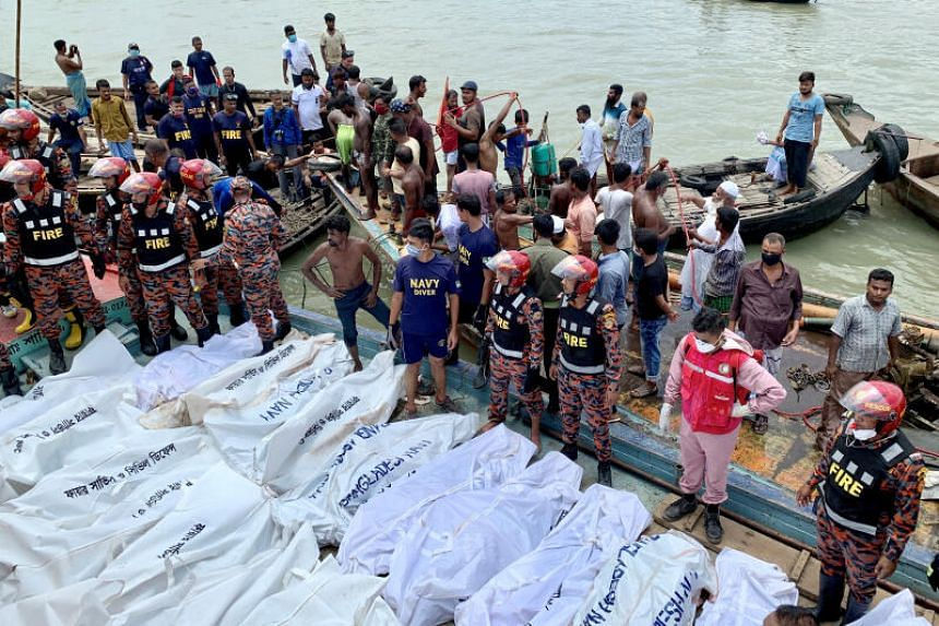 Dead bodies are seen on a boat after a ferry capsized in a river in Dhaka, Bangladesh, on June 29, 2020.