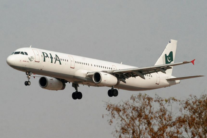 A Pakistan International Airlines plane prepares to land at Islamabad airport in Pakistan.