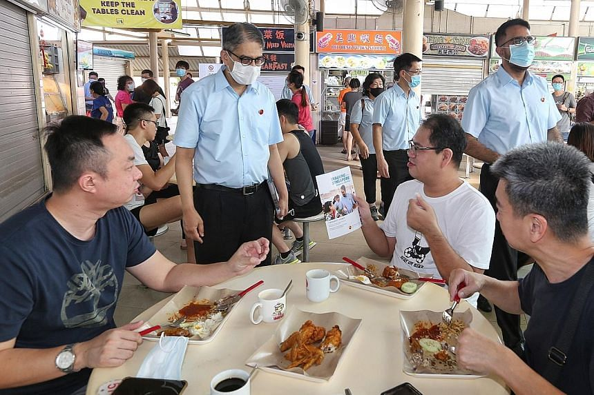 (From left) The Workers' Party's Mr Leon Perera, Mr Gerald Giam and party chief Pritam Singh at Serangoon Garden Market and Food Centre on Sunday. This year, the WP has scaled back its slate and placed all its parliamentarians into the two constituen