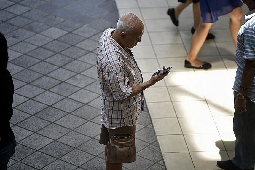 Seniors have to be aged 60 and above, and be receiving ComCare assistance or living in HDB Public Rental Scheme housing, to qualify for the new Mobile Access for Seniors scheme. ST PHOTO: KUA CHEE SIONG