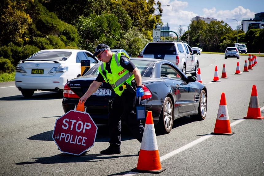 Police man a vehicle checkpoint at the Queensland-New South Wales state border, on April 15, 2020.