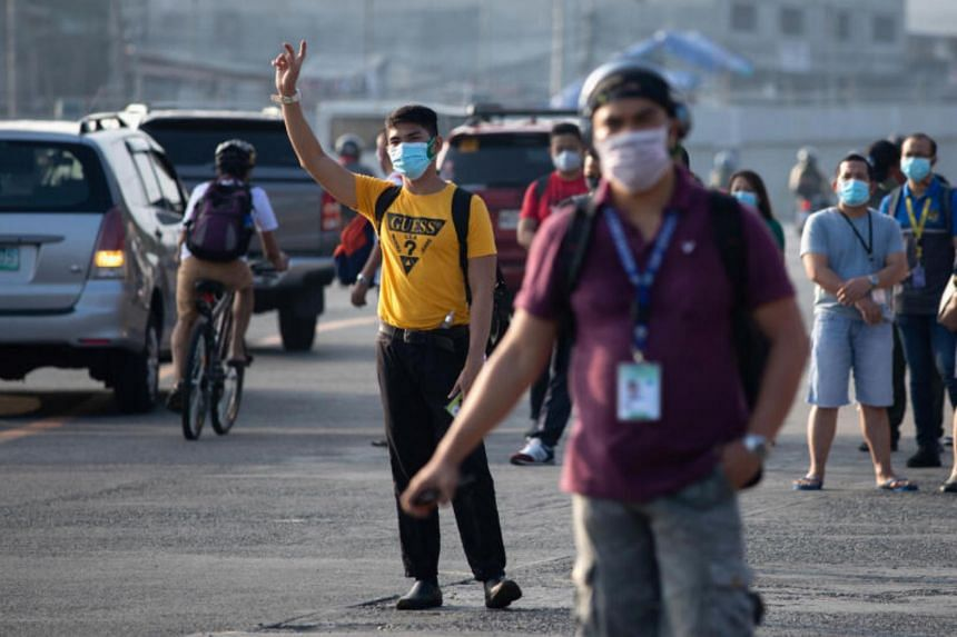 Workers wear protective masks in Quezon City, Philippines, on May 18, 2020.