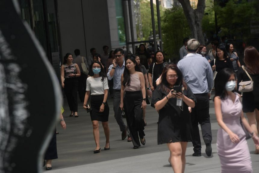 People walking at Raffles Place on Feb 17, 2020.