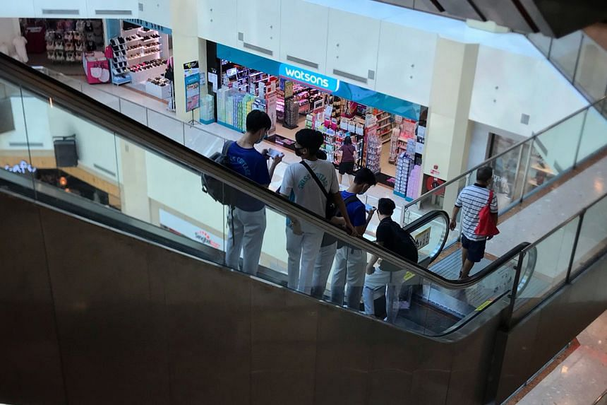 From left: Students at a McDonald's outlet in Bukit Batok Central, hanging out at Tiong Bahru Plaza and West Mall in Bukit Batok. ST PHOTOS: CHONG JUN LIANG, JASON QUAH