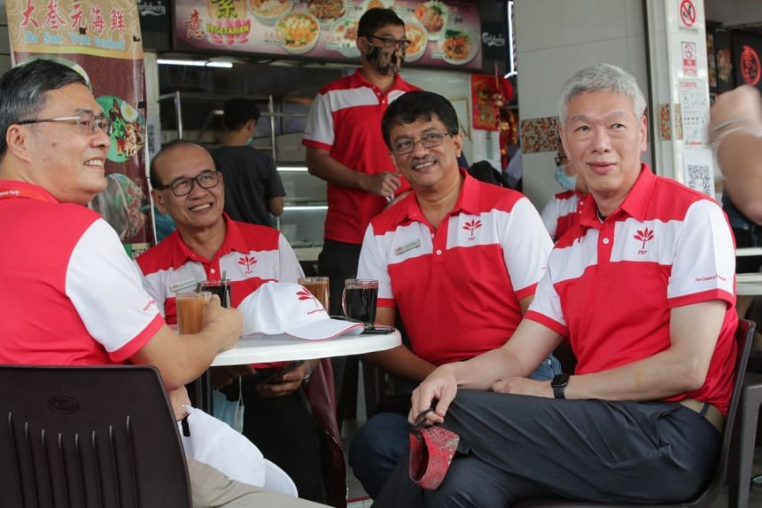 Mr Lee Hsien Yang (right) at a coffee shop near the Bendemeer Primary School nomination centre on June 30.