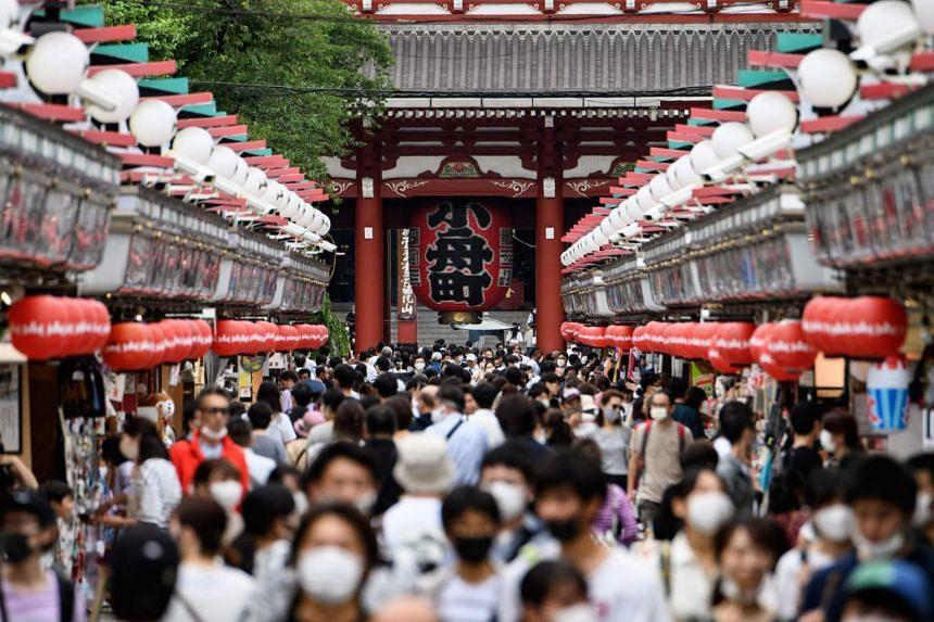 People visit Sensoji temple in Tokyo on June 28, 2020.