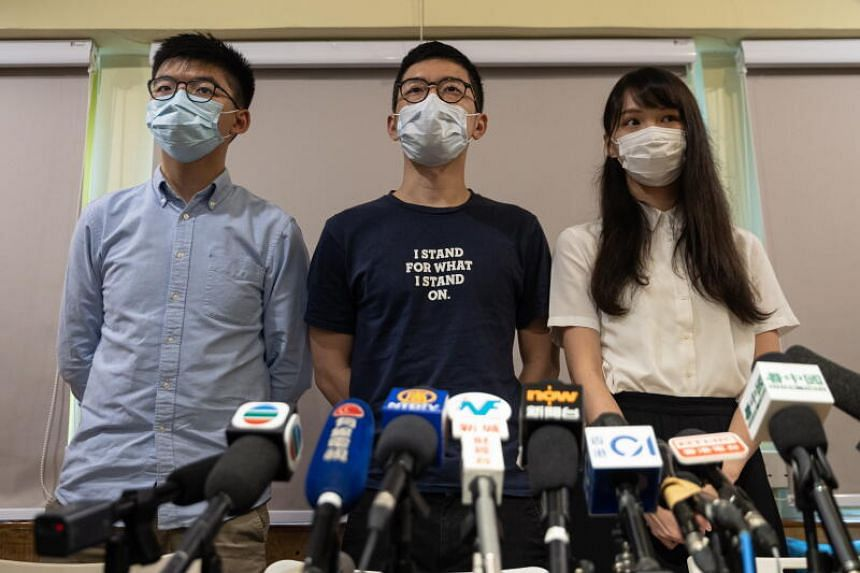 (From left) Members of the pro-democracy political group Demosisto, Joshua Wong, Nathan Law and Agnes Chow at a press conference in Hong Kong on May 30, 2020.