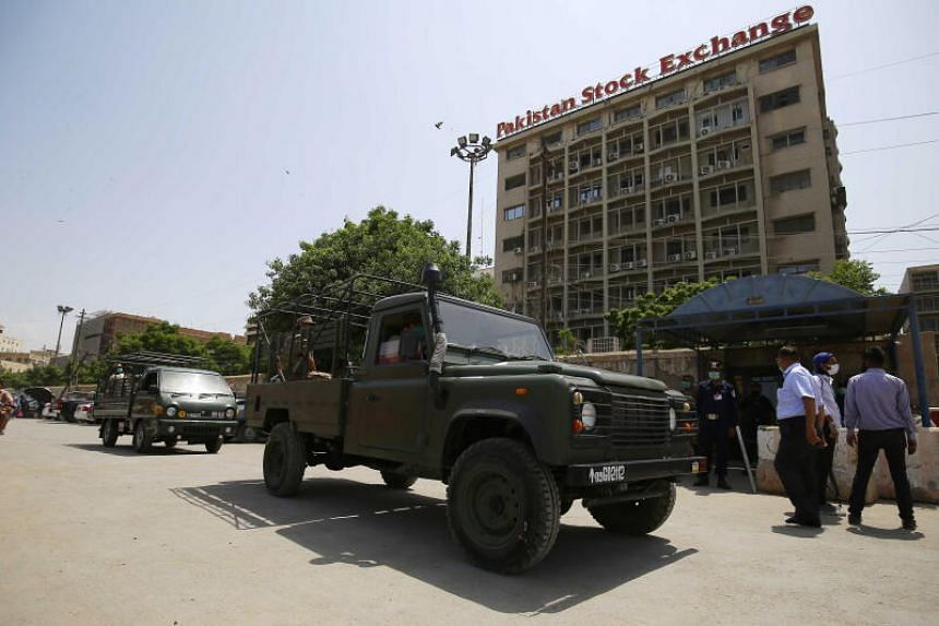 Security officials secure the Pakistan Stock Exchange a day after terrorists attacked the building, in Karachi, on June 30, 2020.
