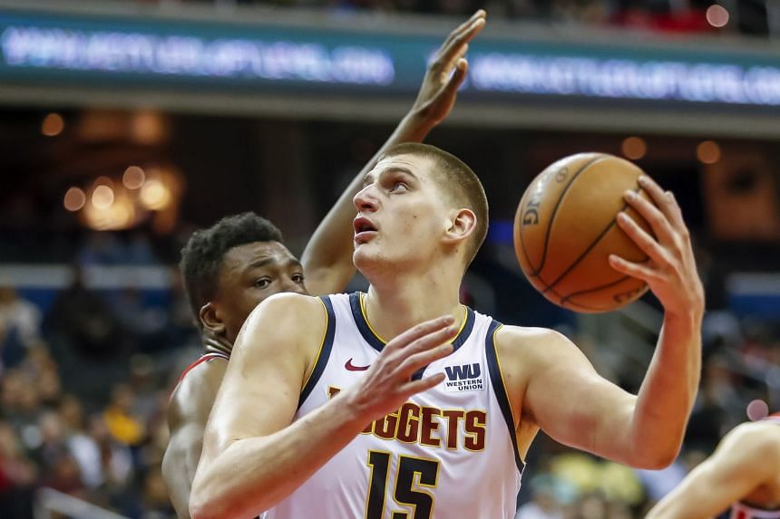 Denver Nuggets centre Nikola Jokic (right) in action against Washington Wizards centre Thomas Bryant during a match in March 2019.