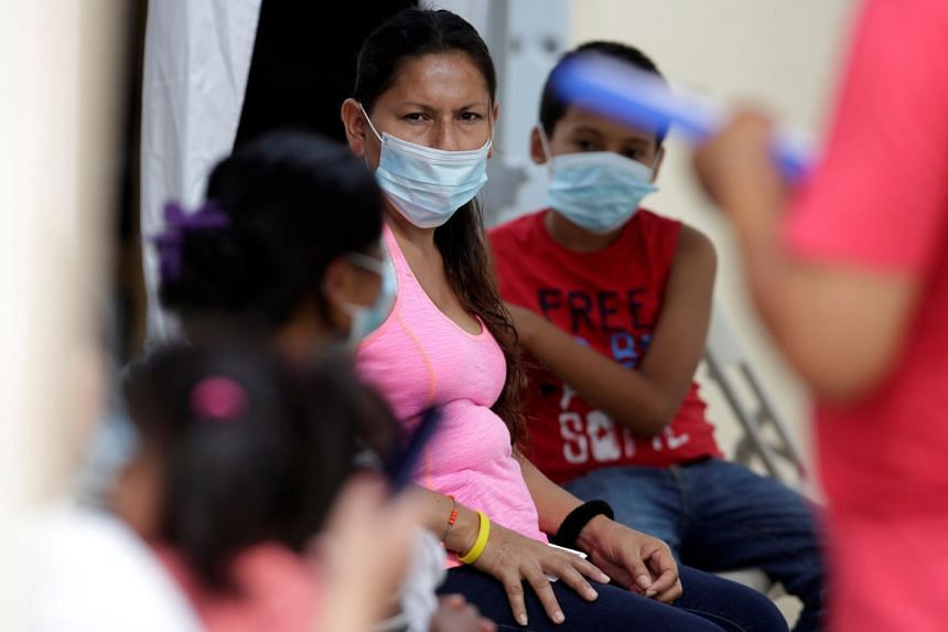 An April 2020 photo shows migrants waiting at a GRM clinic in Matamoros, Mexico.