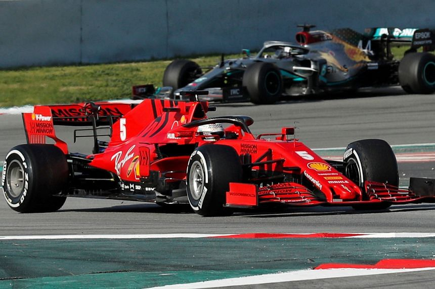 Ferrari's Sebastian Vettel and Mercedes' Lewis Hamilton during pre-season testing in Barcelona, Spain.
