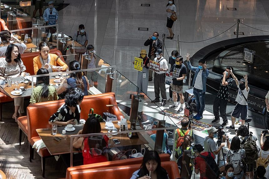 "Pro-democracy protesters taking part in a ""lunch with you"" rally at a shopping mall in Hong Kong yesterday, after China's Parliament approved a national security law for the city that prohibits acts of subversion and secession. Many Hong Kongers fear"