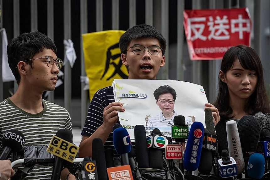 A file photo from June last year showing activists (from left) Nathan Law, Joshua Wong and Agnes Chow. The trio yesterday announced their resignations from the pro-democracy group Demosisto.