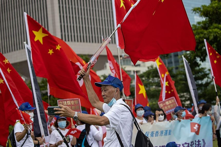 Pro-China supporters at a rally in Hong Kong yesterday. The new national security law effectively bans the sort of protests that have rocked the city for most of the past year, criminalising subversion and collusion with foreign forces. It was promul