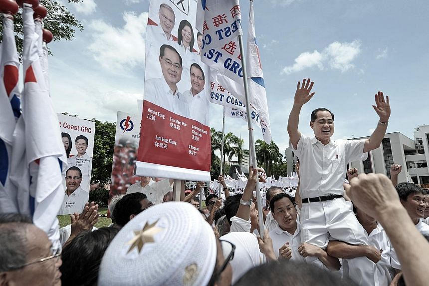 People's Action Party supporters hoisting PAP candidate for West Coast GRC, Mr Lim Hng Kiang, onto their shoulders at the Jurong Junior College nomination centre on April 27, 2011. Mr Lim's team went on to beat the Reform Party at the polls that year