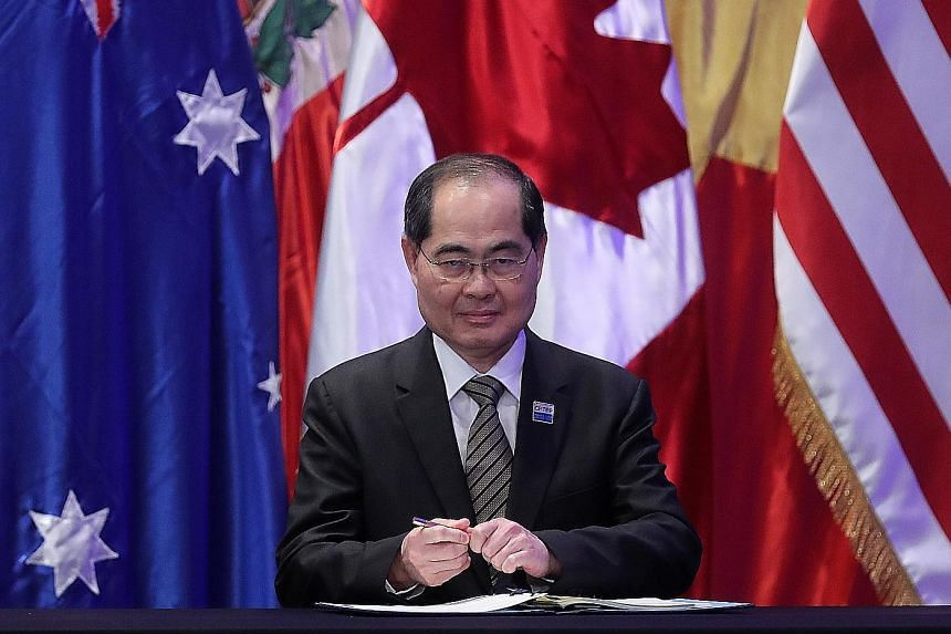 Trade and Industry Minister Lim Hng Kiang signing the Comprehensive and Progressive Agreement for Trans-Pacific Partnership in Santiago, Chile, in March 2018.